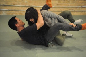 Father and daughter self-defense training together.